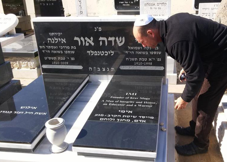 Jew looking at grave of Imi