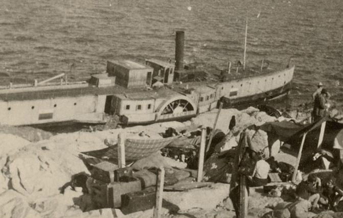 Old photo of boat in marine